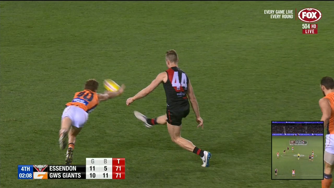 Essendon star Shaun McKernan kicks a vital goal in the final two minutes before replays show that it was touched by the defender