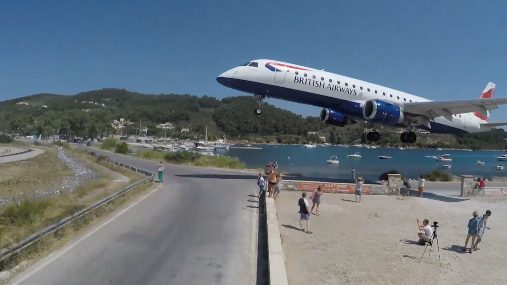 British Airways plane narrowly misses spectator's heads as it lands at Greek airport