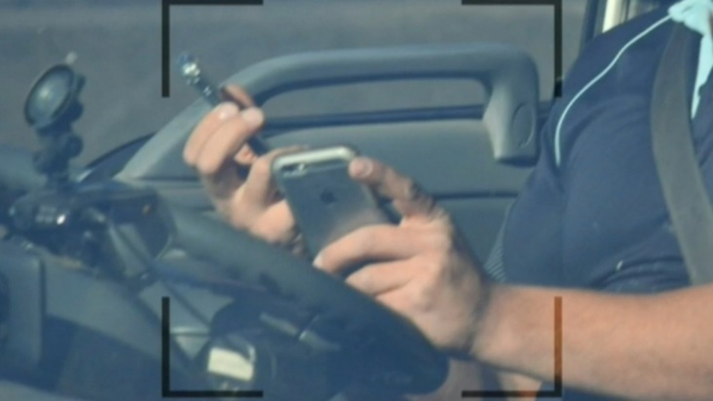 Australia to use cameras to catch drivers using phones while driving