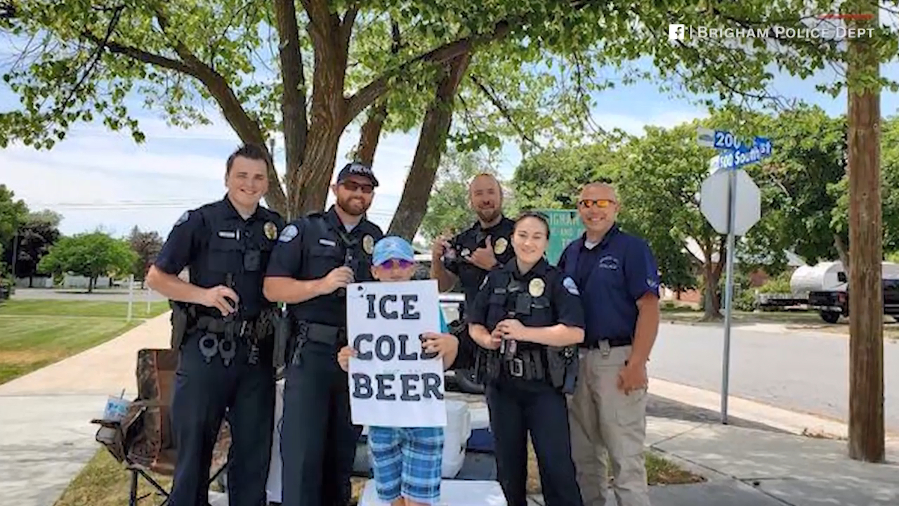 Boy catches police's attention with 'ice cold beer' sign