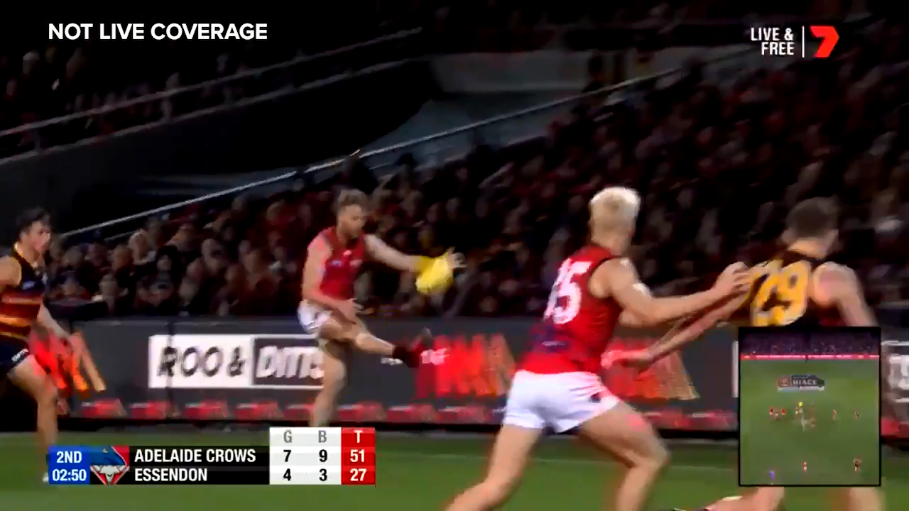 Essendon star Jake Stringer kicks a banana from the wrong side of the pocket to stay in touch with Adelaide