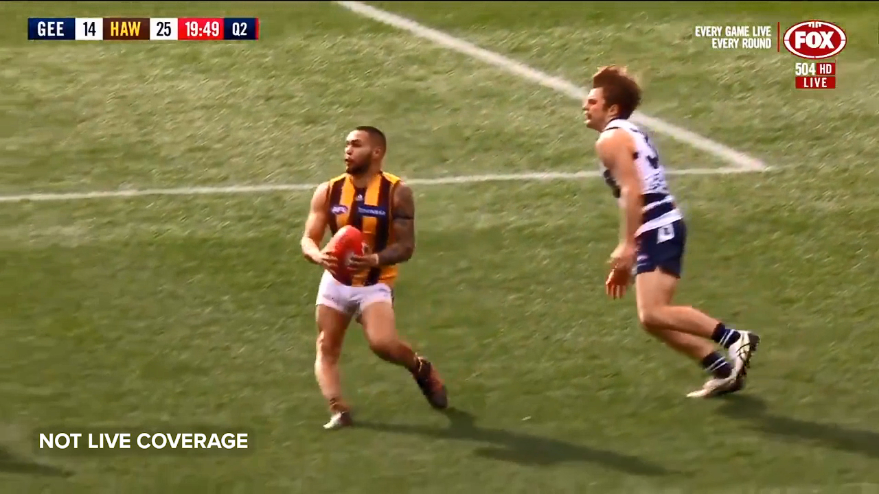 Hawthorn star Jarman Impey lands awkwardly after a marking attempt and is helped off the MCG