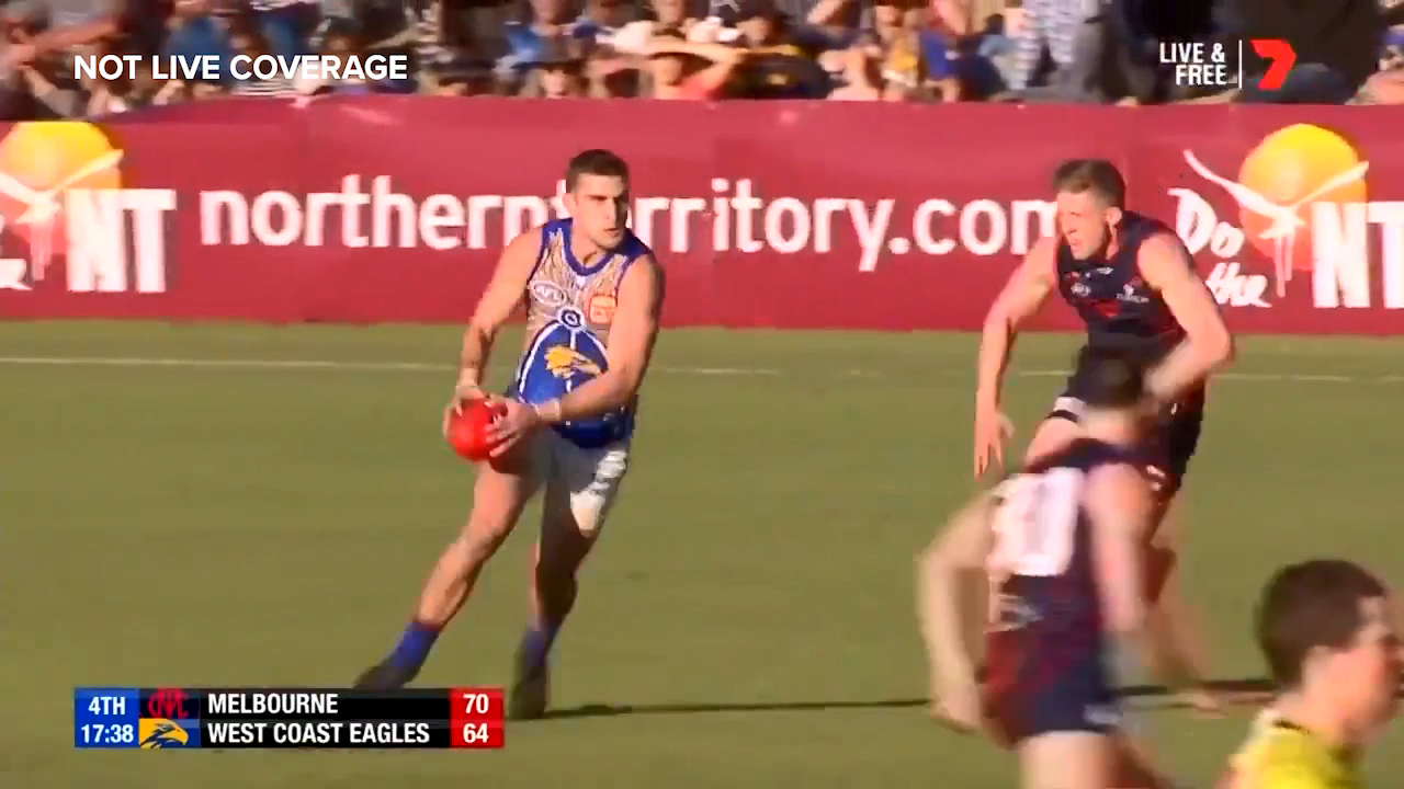 Elliot Yeo hits his opponent with a double-fake before nailing the running goal from 50m against Melbourne