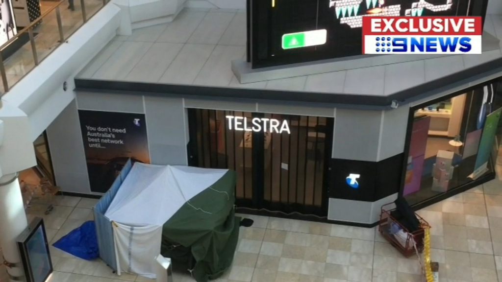 Man falls to his death at shopping centre