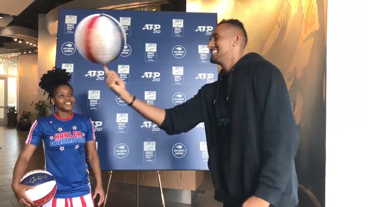 Kyrgios hangs with a Harlem Globetrotter