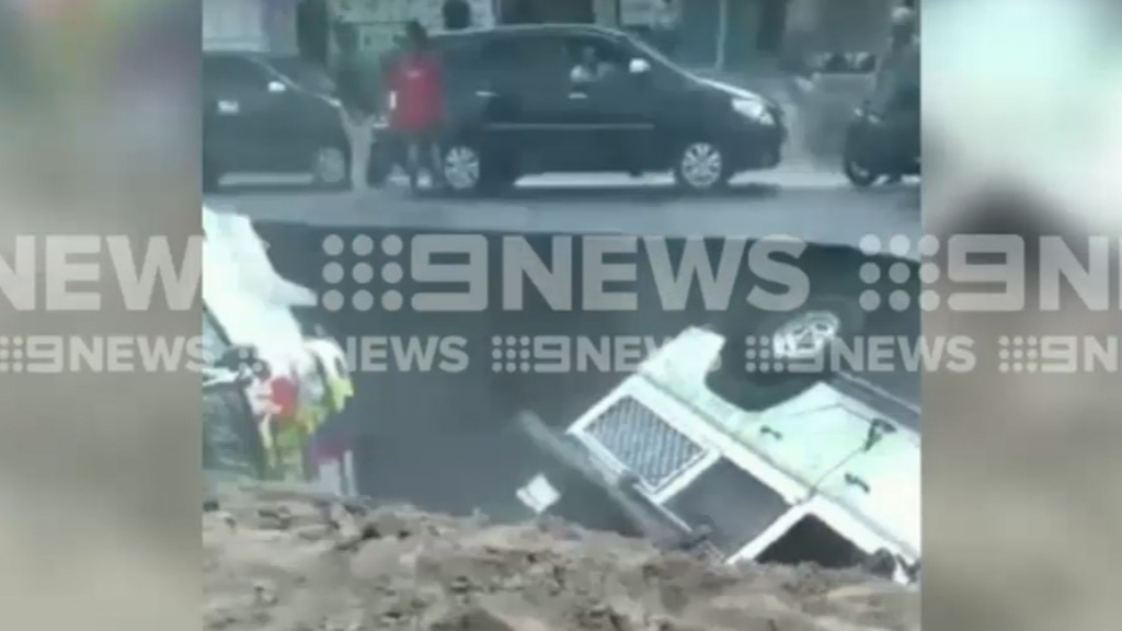 Melbourne family's land rover falls into collapsed Indonesian road