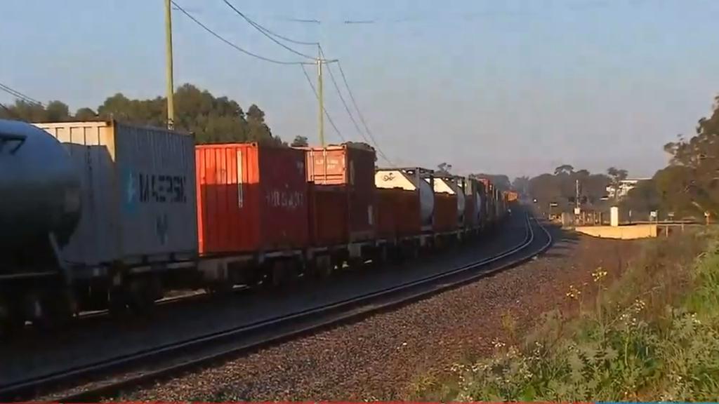 Perth cargo train derails after crashing into car