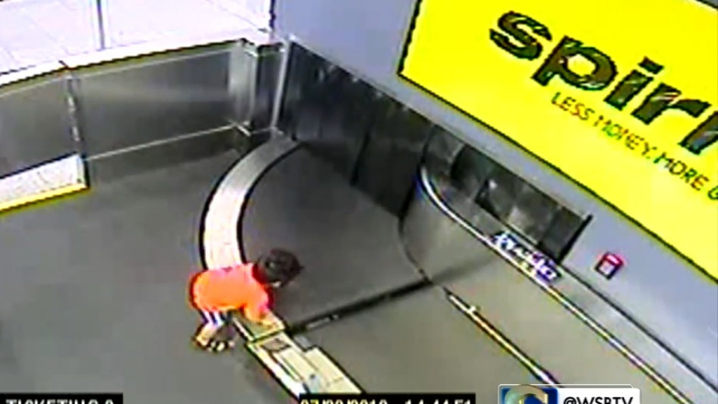 Boy hurt after riding on airport conveyor belt