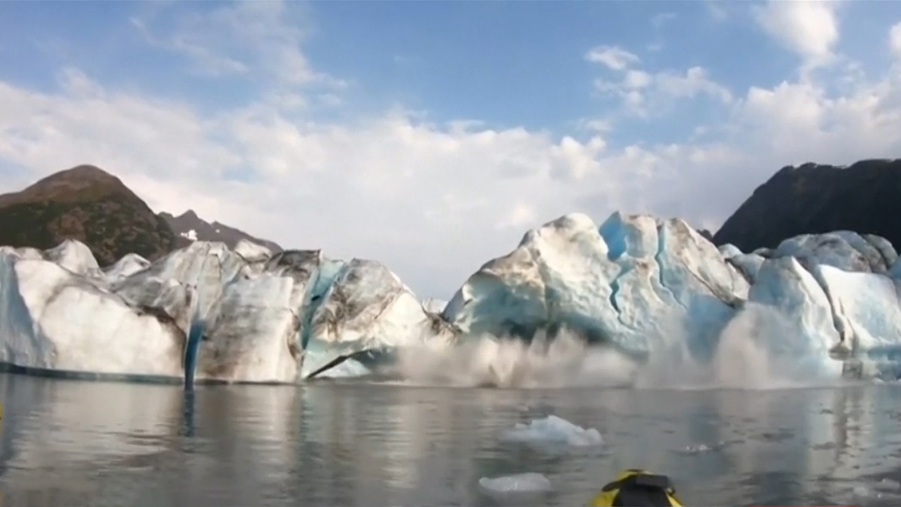 Kayakers' brush with death after glacier collapse