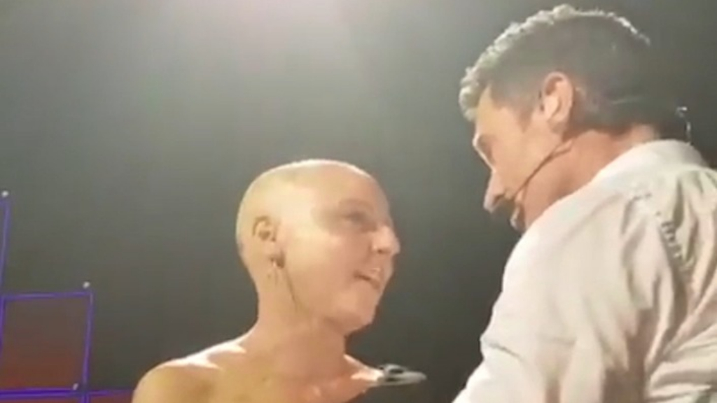 Hugh Jackman comforts breast cancer sufferer on stage
