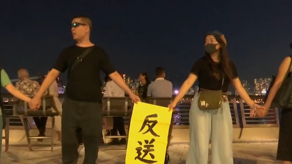 Protesters form human chain across Hong Kong