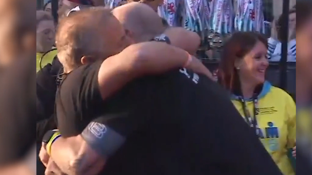 Thomas embraces husband after Ironman