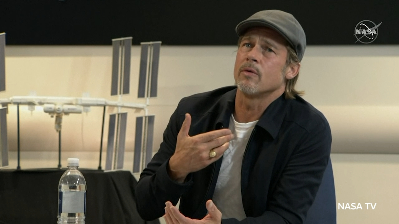 Brad Pitt makes a phone call to an astronaut in an International Space Station