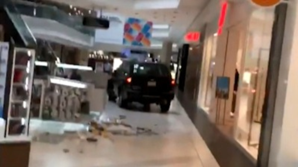 SUV tears through shopping centre