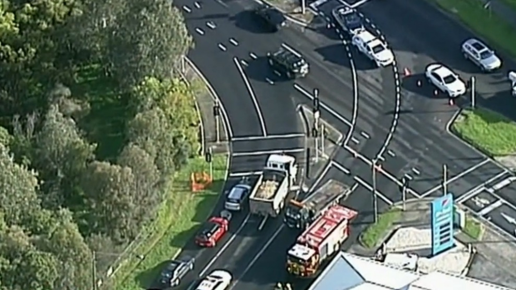 Upended car causing traffic delays in Melbourne