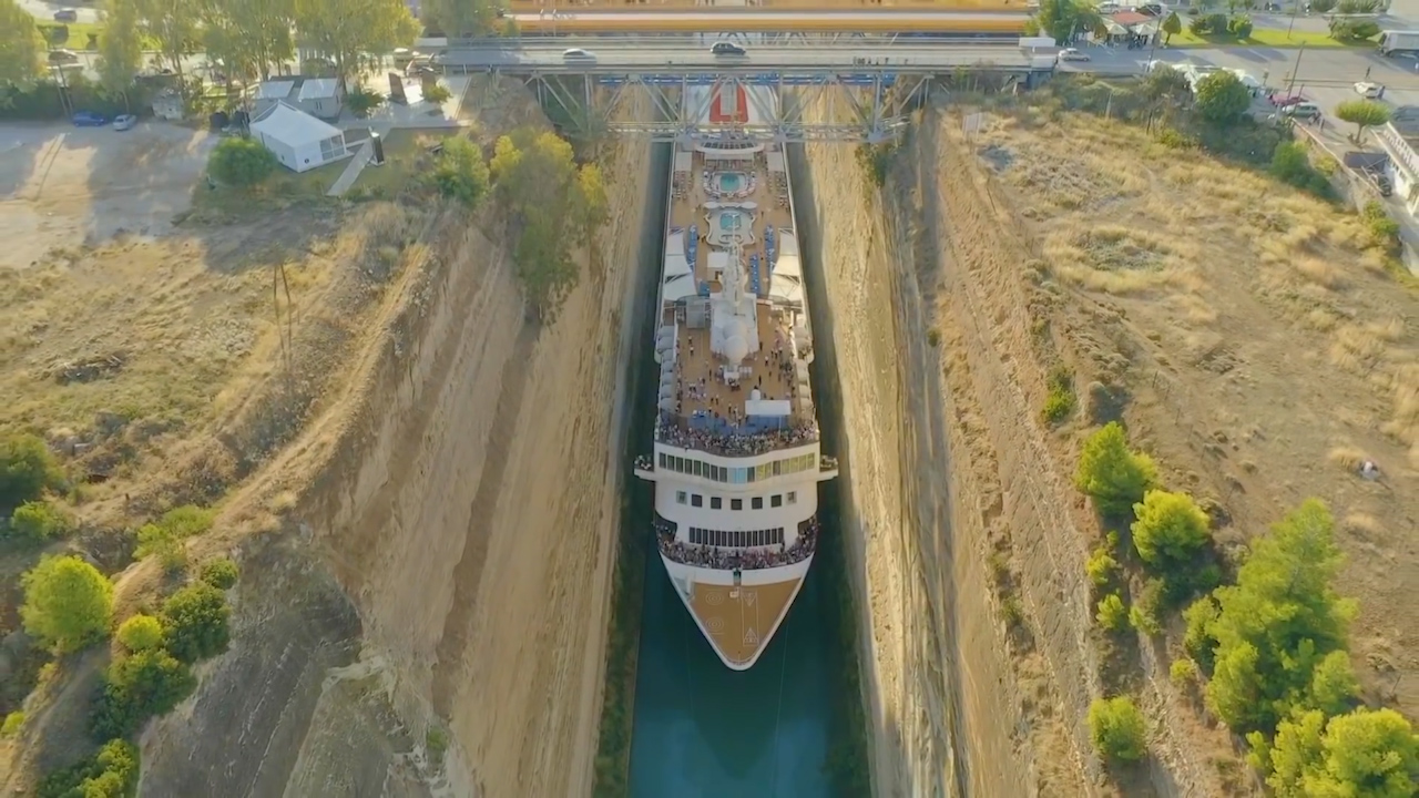 Huge cruise ship squeezes through Greek canal to claim record