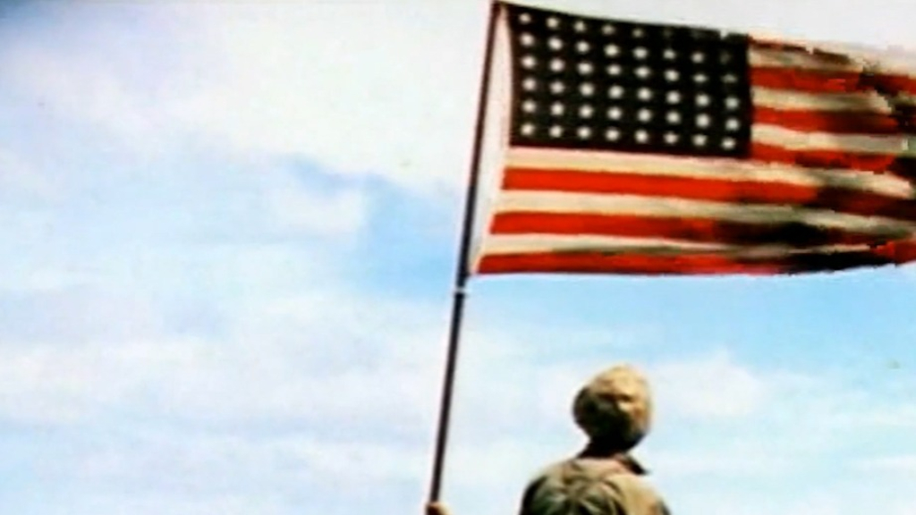 US flag being raised above Iwo Jima