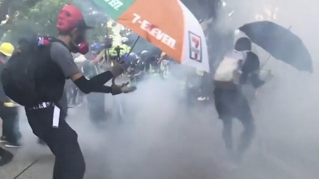 Hong Kong protesters defy ban