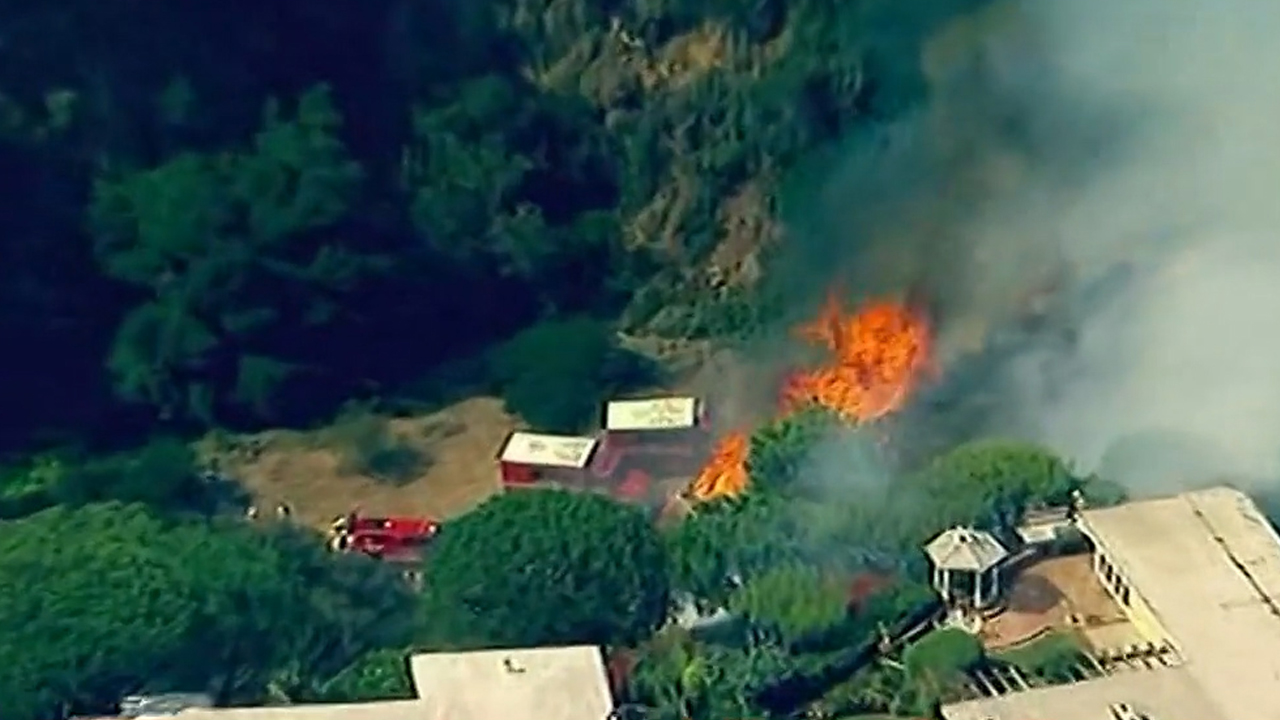 Palisades Fire in Los Angeles burns more than 30 acres, threatens homes