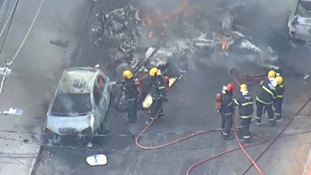 Three people dead after plane crashes in street