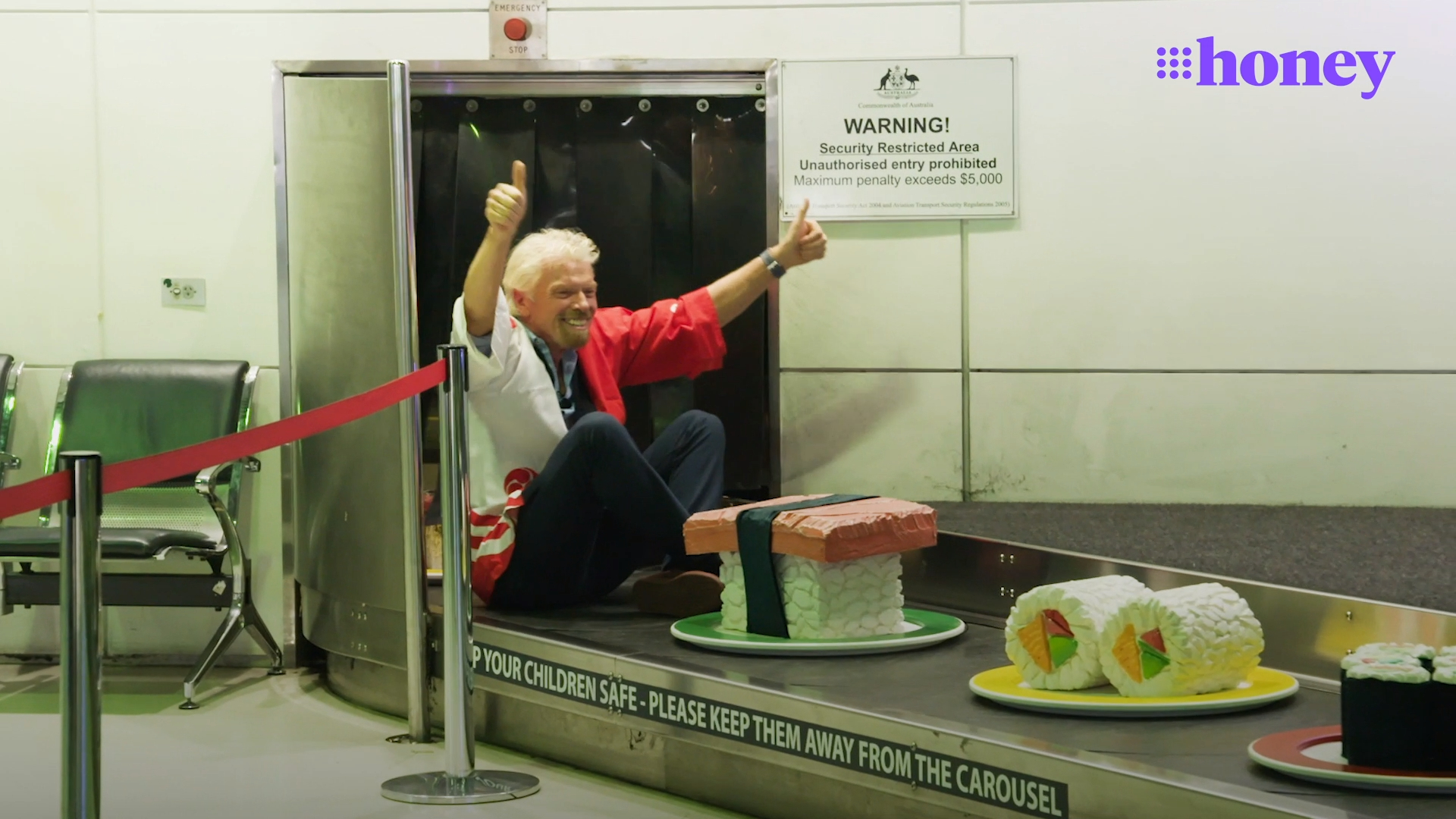 Sir Richard Branson surprises travellers in airport stunt