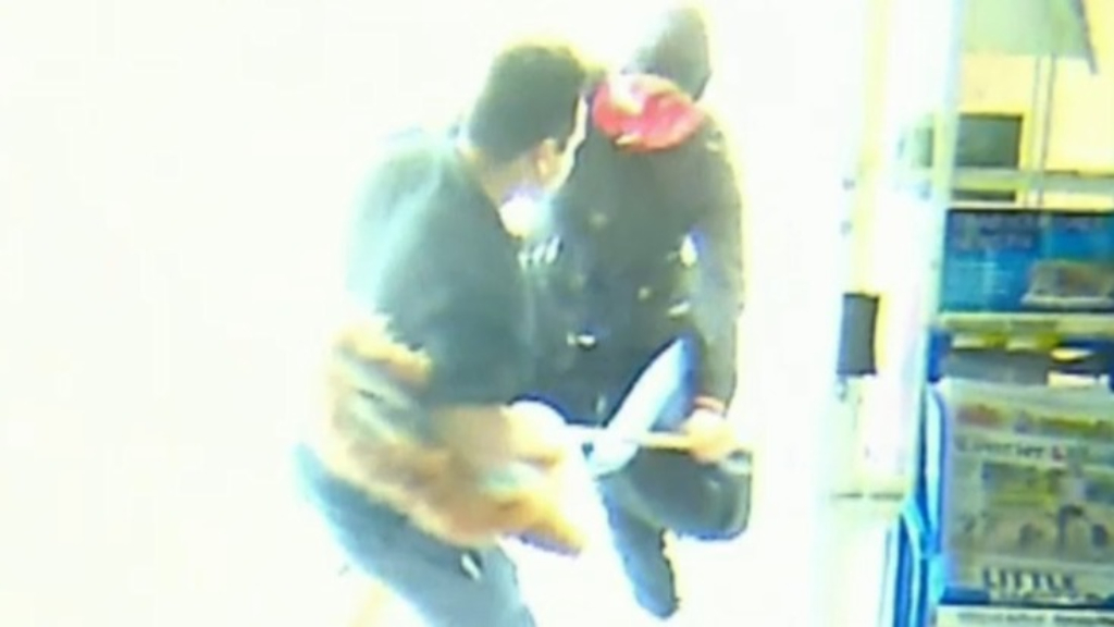 Man with mop takes on armed robbers