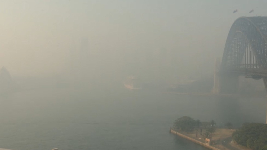 Thick smoke blankets Sydney Harbour