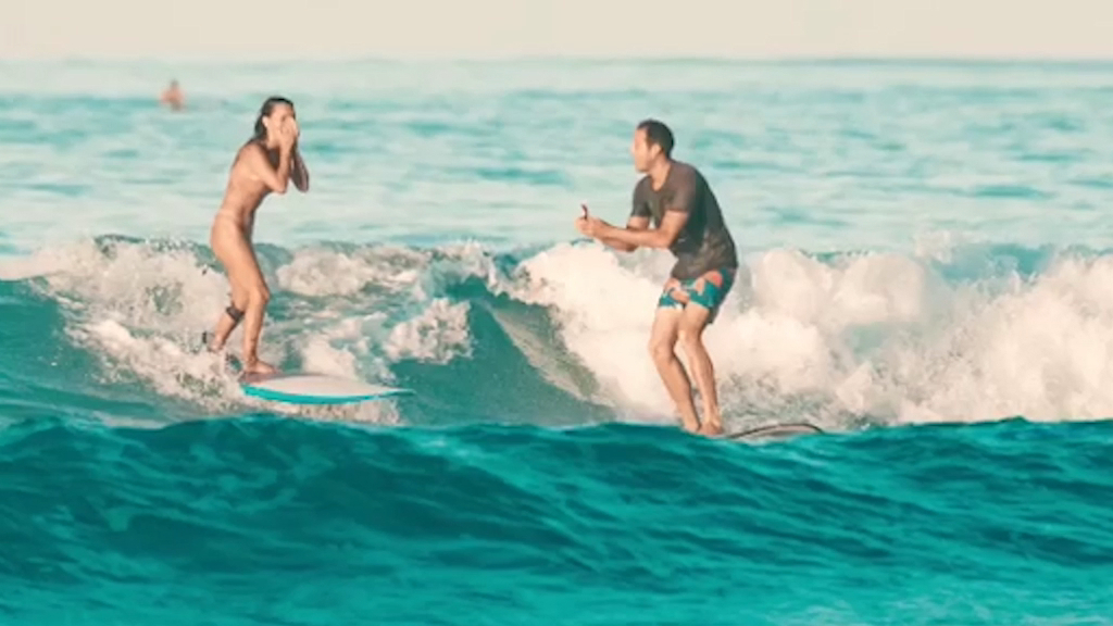 Man proposes to girlfriend while surfing - then drops the ring