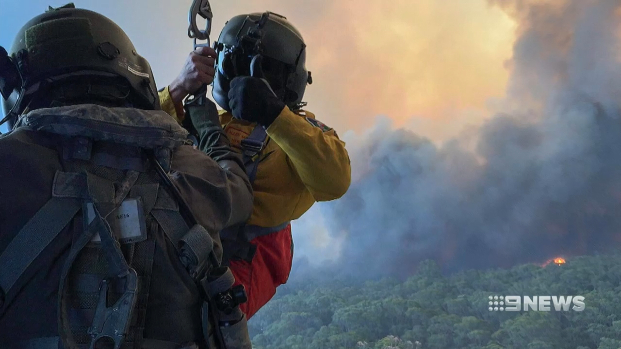NSW Bushfires: Navy helicopter saves families