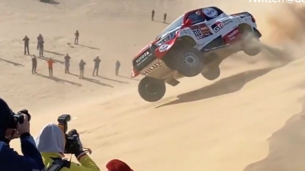 Alonso rolls Toyota during Dakar Rally