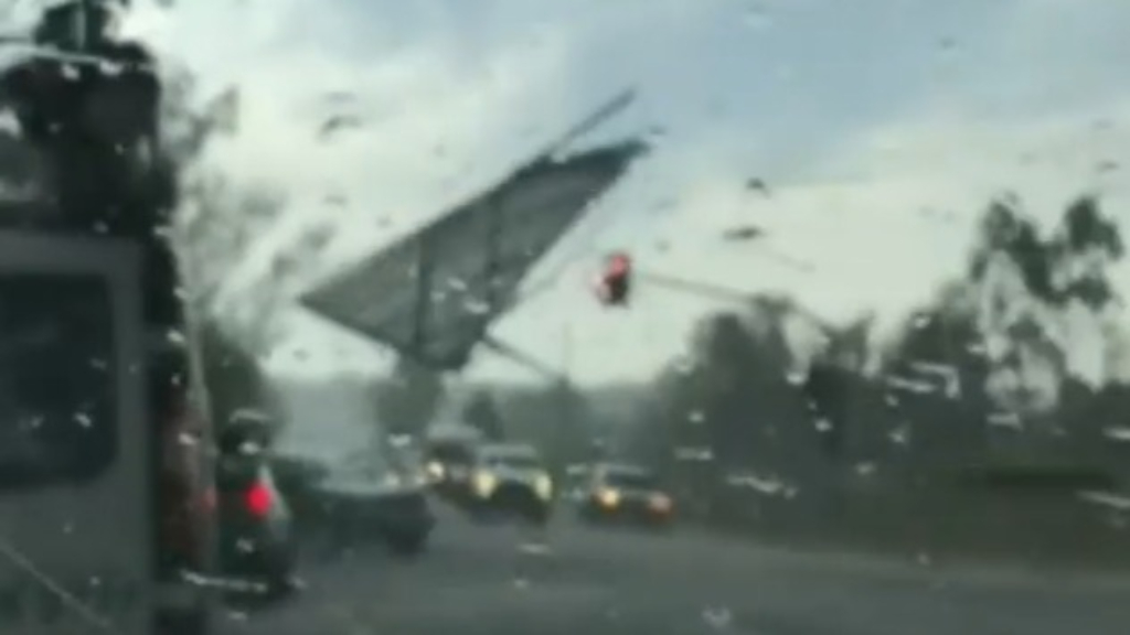 Roof ripped off shopping centre crashes onto traffic