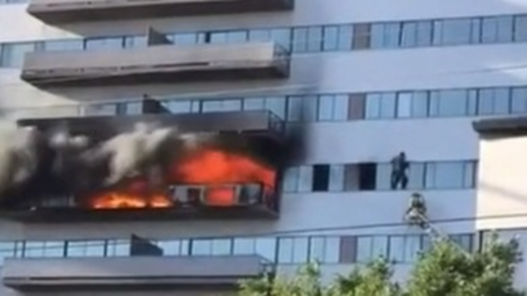 LA tower block residents leap to safety after fire breaks out