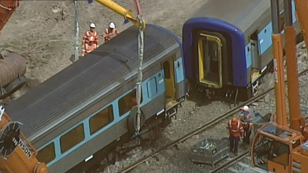Section of derailed train removed from track