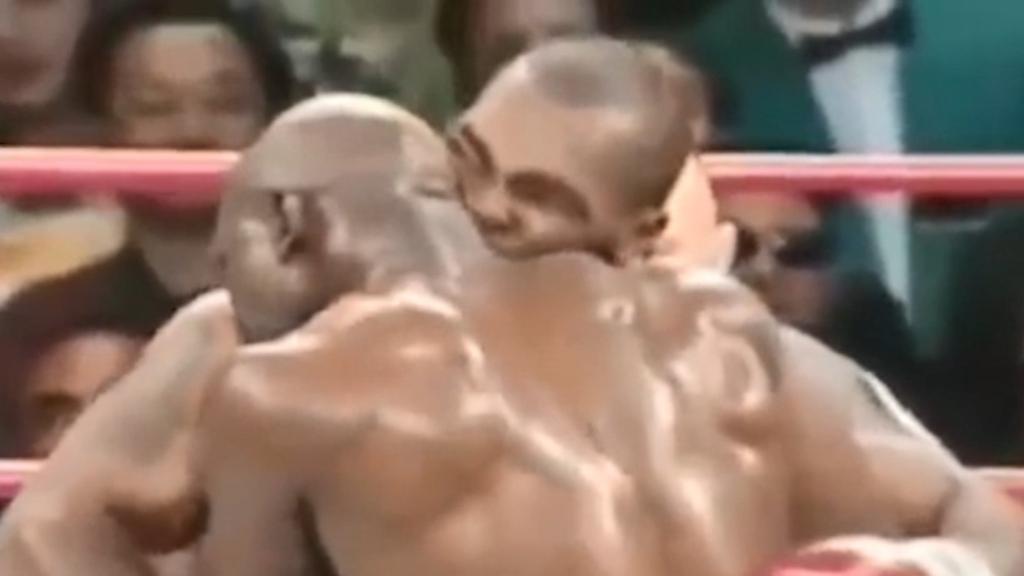 Tyson bites Holyfield's ear off