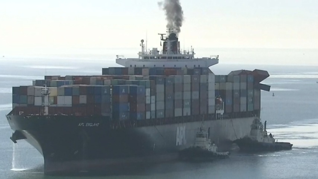 Cargo ship with damaged containers docked in Brisbane