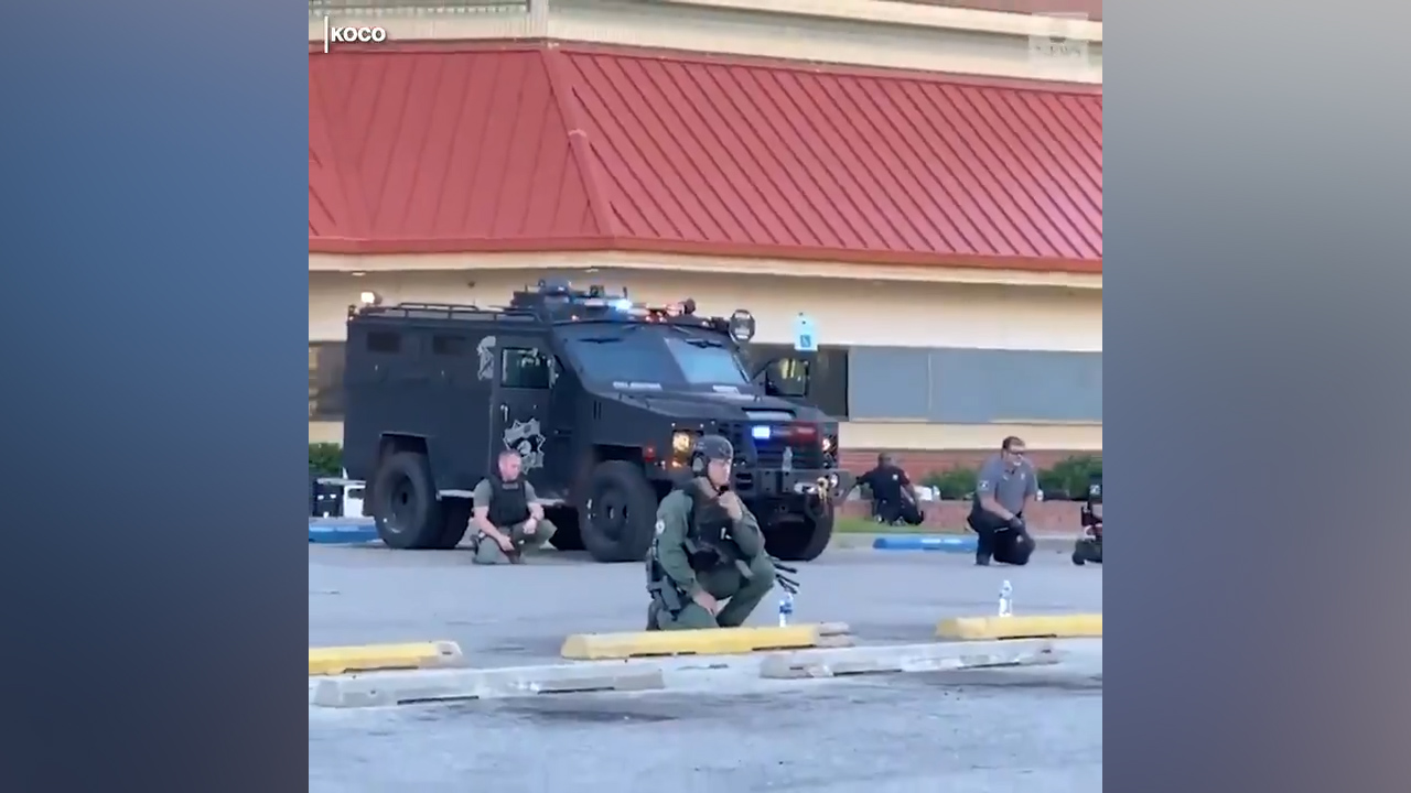 Oklahoma police kneel with protesters