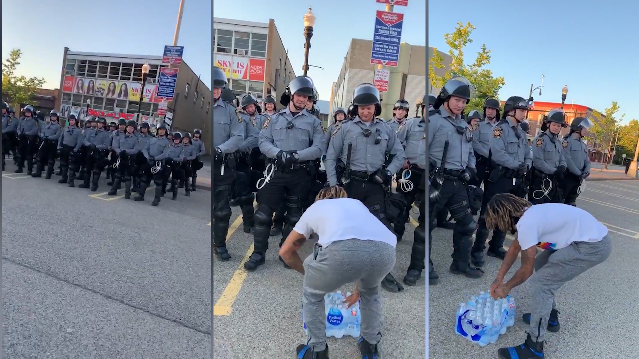 US protests: US protester donates water to police in 'wonderful' peace-offering