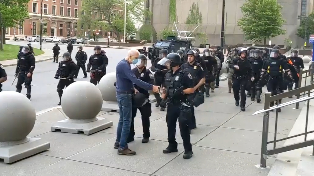 Buffalo police officers suspended after video shows them pushing protester