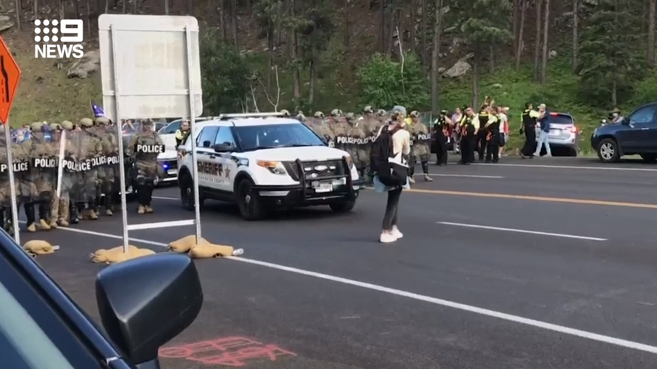 Police attempt to disperse Native Amercian protestors