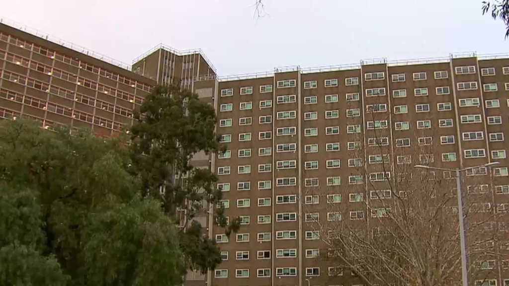 Melbourne locks down tower blocks as cases rise