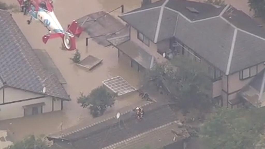 Japan floods leave up to 34 dead