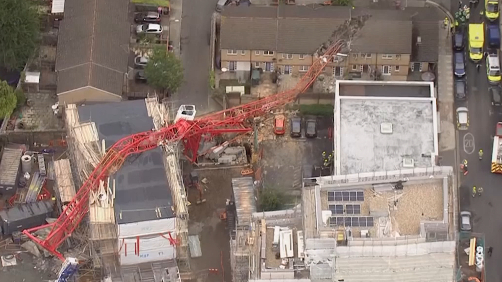 One dead, four hurt as 65ft giant crane 'snaps'