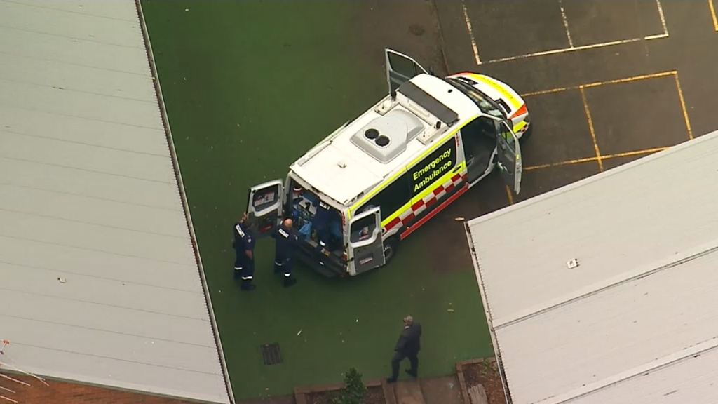 Man unconscious after falling from roof in Sydney