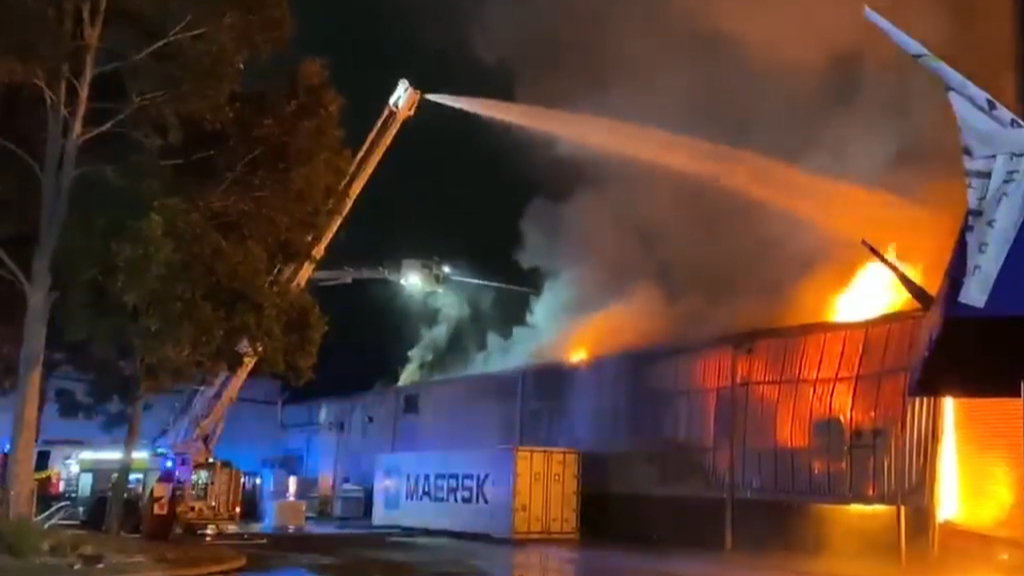 Firefighters battle massive Moorebank factory blaze