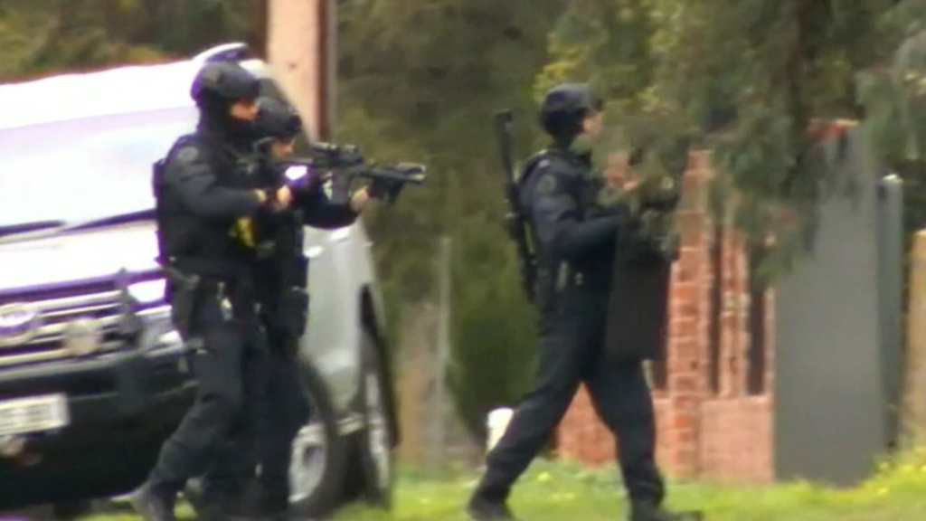 Heavily armed police storm North Adelaide property