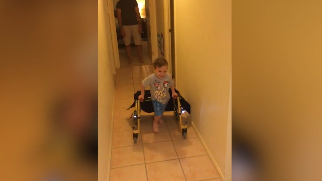 Josh with cerebral palsy practicing walking