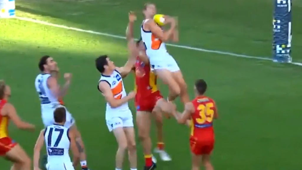 Harry Himmelberg takes a stunning mark for the Giants