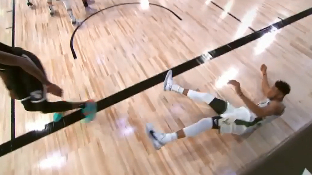Giannis flips at Donta Hall