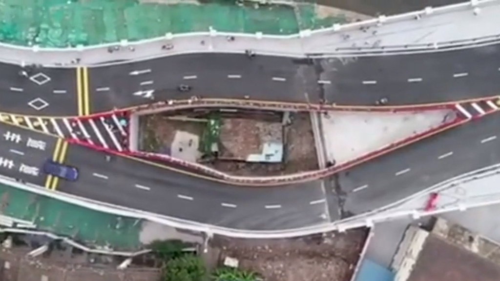 China news: Motorway built around woman's house after she refused to move