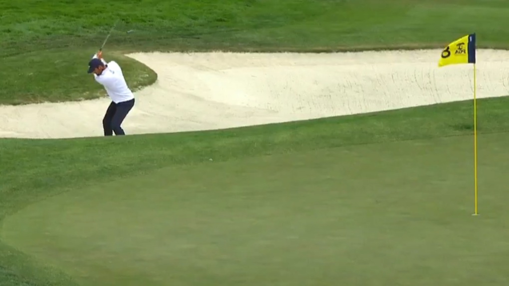 Scheffler holes out from the bunker